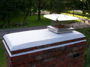 "Shown here is a chimney that has been protected by waterproofing the brick, ""crown coat"" on top, and a stainless steel cap to keep water out of the fireplace."