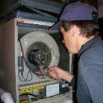 We also clean out the air coil and furnace blower compartment as shown here.
