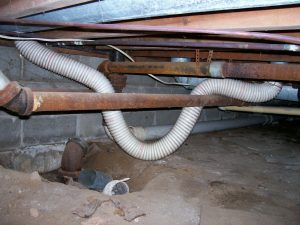This vinyl dryer vent installation in a crawl space is unsafe and not very efficient.