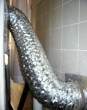 A fire hazard has been corrected by installing a metal foil flexible connector between the dryer and vent.